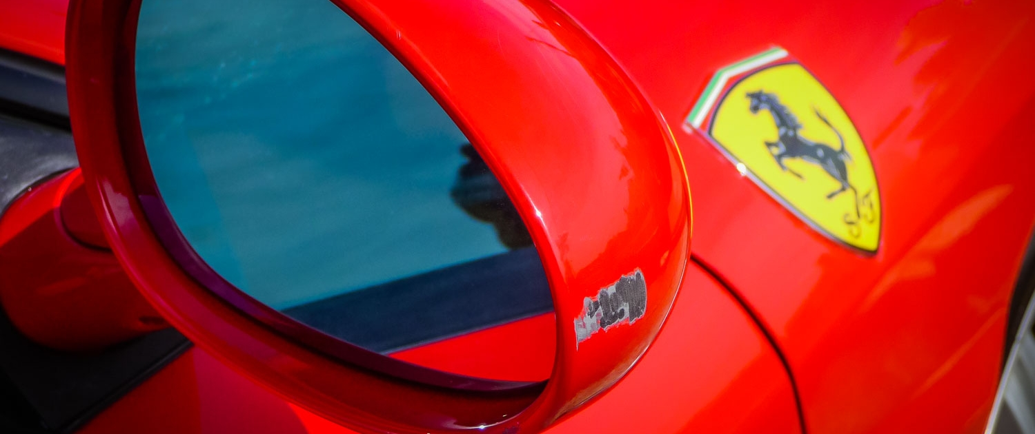 Attention to Detail mobile smart repairs paint scratch tidy ups to ferrari mirror image by Ian Skelton Photography