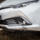dented front bumper side view before Attention to Detail mobile smart bumper repairs