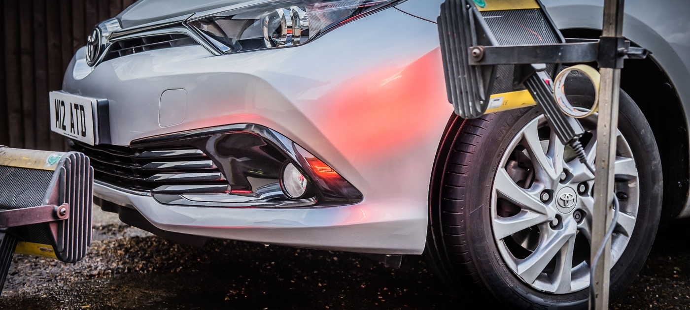 Toyota Auris front bumper under infrared lamps after Attention to Detail mobile smart bumper repairs image by Ian Skelton Photography
