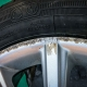 Ford Focus alloy wheel damage before repair by Attention to Detail mobile smart repairs alloy wheels image by Ian Skelton Photography